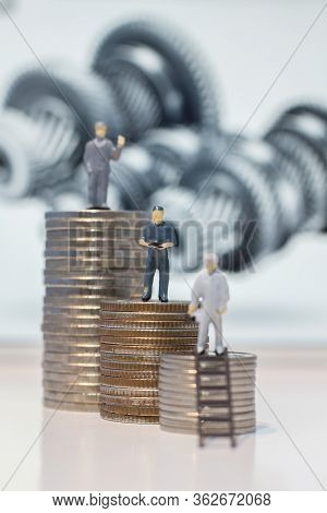 Miniature People Engineer Standing On Coins, Success People Miniature Business (teamwork Concept)