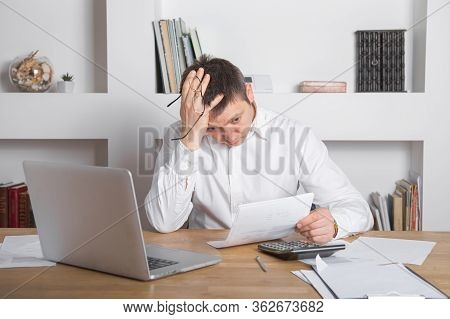 Businessman Receiving Negative News, Touching His Glasses, Being Mad, Upset And Surprised In Front O