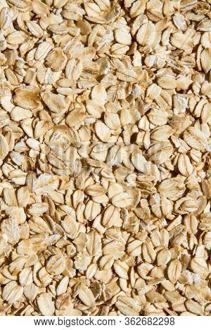 Close Up. Dry, Raw  Oatmeal  ( Oat Flakes, Rolled Oats )  Background Or Texture.