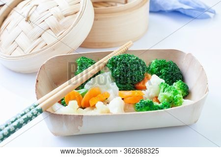 Assorted Boiled Vegetables On Wooden Bowl With Chopstick