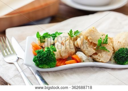 Deep Fried Fish Served With Assorted Vegetables