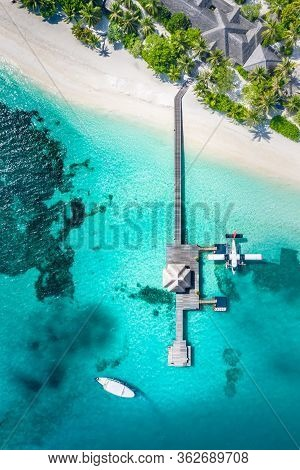 Perfect Aerial Landscape, Luxury Tropical Resort Or Hotel With Water Villas, Seaplane And Wooden Boa