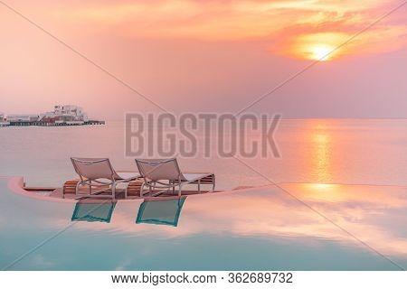 Perfect Beach Sunset, Relaxation Pool In A Luxurious Beachfront Hotel Resort In Sunset Light Perfect