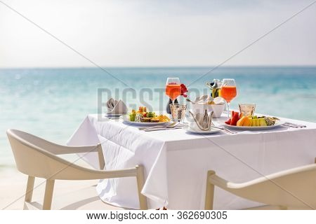 Luxury Breakfast Food On White Table, With Beautiful Tropical Sea View Background, Morning Time Summ