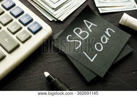 Sba Loan Handwritten Memo On The Calculator.