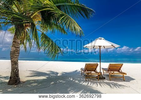 Maldives Beach With Luxurious Water Villas And Loungers Beautiful Tropical Scene. Luxury Summer Trav