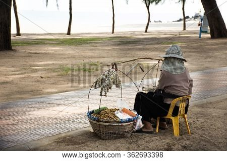 Old Thai Woman People Vendor Bearing Hawker Basket Sitting Sale Food And Snack For Travelers On Stre