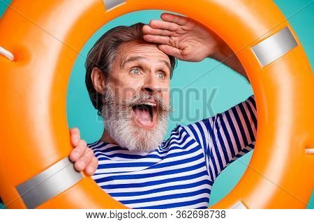 Earth. Closeup Photo Of Interested Funny Aged Guy Seaman Open Mouth Tourist Look Inside Lifebuoy Wat