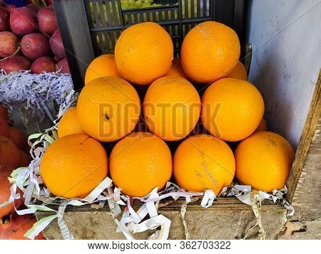 Selling Juicy Fresh Ripe Orange, Closeup. Wholesale Market. Orange In A Box. Selling Crops On The Ma