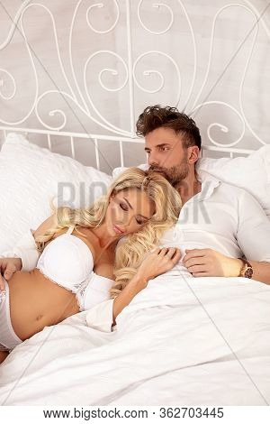 Romantic Couple Relaxing In Bed.