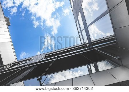 Bottom View Of Modern Office Building With Amazing Sky. Economy Restart Concept. Reopen Economy Afte