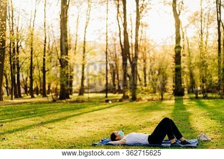 Woman With Mask Meditating, Daydreaming In Nature Alone.social Distancing,healthy Lifestyle. Mindful