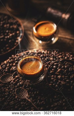 Cup Of Espresso Coffee On Coffee Beans Background