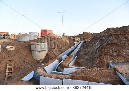 Installation Of Concrete Sewer Wells In The Ground At The Construction Site. Improvement Of Wells An