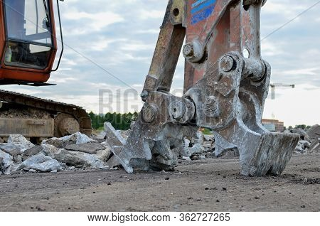 Excavator With Hydraulic Shears For Cutting And Crumbles Demolition Concrete And Asphalt At Construc