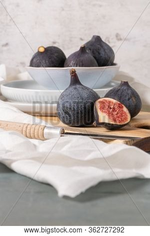 Fresh Ripe Figs On A Wooden Table. Healthy Mediterranean Figs. Beautiful Blue Purple Figs, Selective