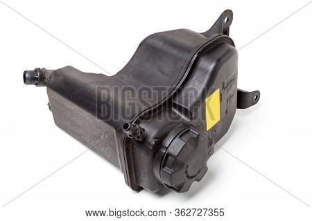 Coolant Expansion Tank In Black On A White Isolated Background With A Yellow Nameplate. The Unit Of
