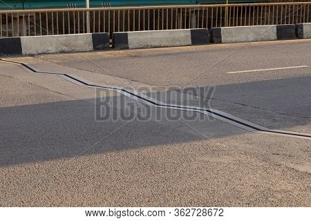Mobile Drainage Connection On The Carriageway Of The Bridge. Metallic Zigzag Edge Of Drainage Channe