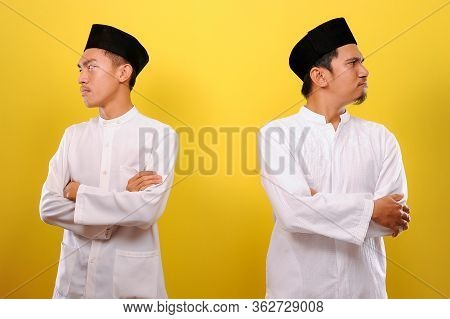 Image Of Two Young Asian Muslim Men Hating Each Other, Not Greeting Each Other When Ramadan. Ramadan