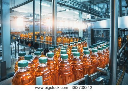 Conveyor Belt, Juice In Bottles, Beverage Factory Interior In Blue Color, Industrial Production Line
