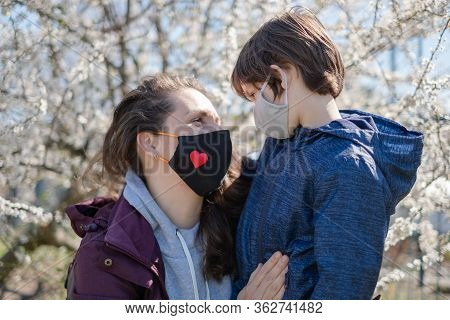 Mother With A Small Son In Protective Masks Went For A Walk From Home. The City Is In Quarantine.