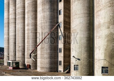 Old Vintage Abandoned Grain Silo With Checkpoint. Grain Terminal Storage Old Silos, Very Rustic. Agr