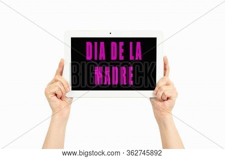 Woman's Hands Holding Tablet With Text On Mother's Day In Spanish On A White Background