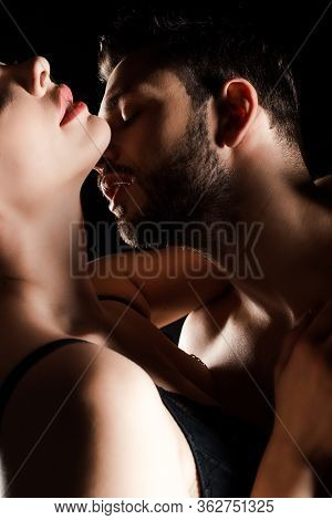Cropped View Of Seductive Girl Embracing With Sexy Man Isolated On Black