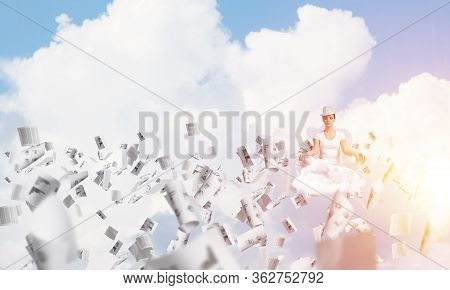 Woman In White Clothing Keeping Eyes Closed And Looking Concentrated While Meditating Among Flying P