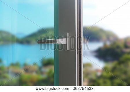 Sliding Door Of A Balcony. Close-up Of The Lock On The Door With And Nice Landscape Of Background. W