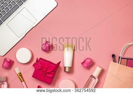 Concept Of Online Shopping Cosmetics. Top View On Cosmetics Bottles, Cream, Soap, Makeup Brushes, Co