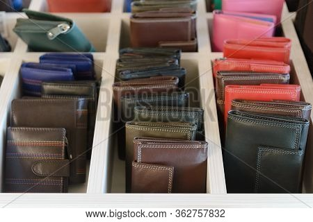 Store Counter With Multi-colored Leather Wallets Close-up