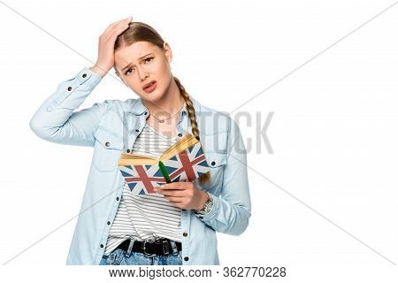 Tense Pretty Girl With Braid Reading Book With Uk Flag And Touching Head Isolated On White