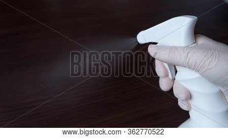 Spraying An Antibacterial Disinfectant Spray. Dispenser Of Disinfectant For Surfaces. Concept Of Inf