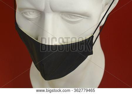 Julius Caesar In A Protective Black Mask. Coronavirus Protection.