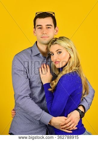 Happy Couple. Couple In Love. Family Couple Hugging On Yellow Background. Caucasian Man And Sexy Wom