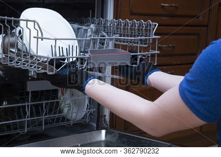 Repair Of Dishwashers. The Master Has Come Home And Is Repairing The Dishwasher.