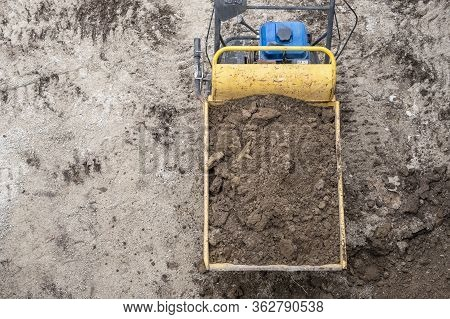 Birds Eye View Of A Power Wheelbarrow Filled With Dirt On A Construction Site