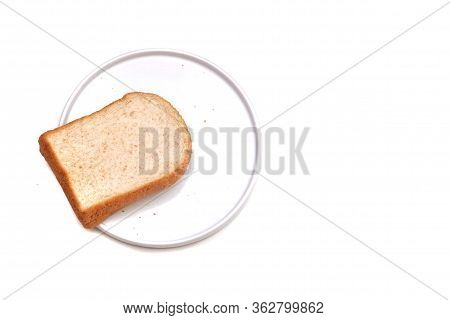 A Piece Of Sliced Wholewheat Bread On A White Plate, White Isolated Background