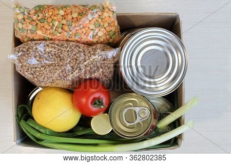 Cardboard Box With Food Supplies Crisis Food Stock For Quarantine Isolation Period On Light Backgrou