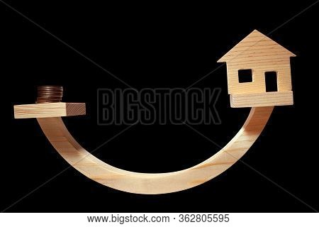 Balance Concept, Curved Wooden Board As Balance Isolated On The Black Background, Balancing On A Swi