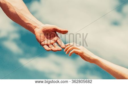 Giving A Helping Hand. Lending A Helping Hand. Hands Of Man And Woman Reaching To Each Other, Suppor