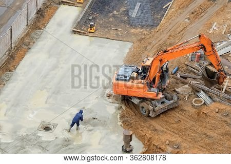 Concrete Pouring On Construction Site.  Worker Smoothing Concrete By Trowel To Finish Concrete Floor