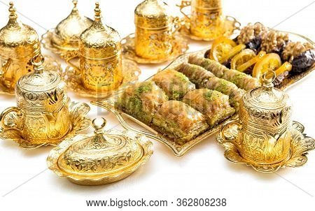 Arabic Food Delight, Tea Cups And Golden Decorations. Oriental Hospitality