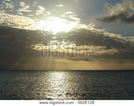 Cloudy Sunrise Over The Ocean