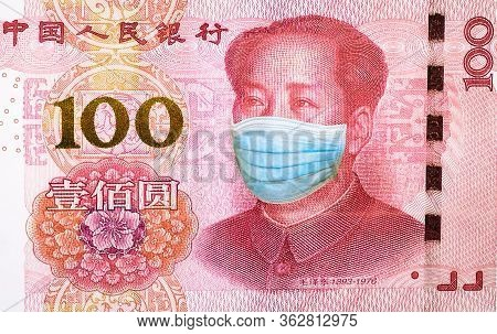 Surgical Mask Of Mao Tse-tung On 100 Chinese Yuan Banknote Close-up. Business Concept Of Covid 19-nc