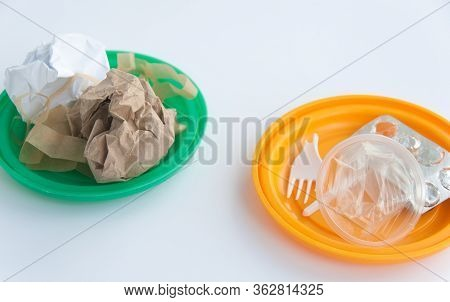 Household Waste Sorting System. Plastic Cups, Paper, Carton. Two Colourful Plates With Paper Waste O