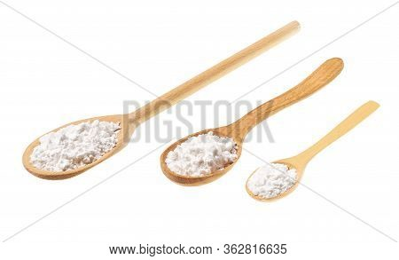 Corn Starch In A Wooden Spoon Isolated On A White Background.