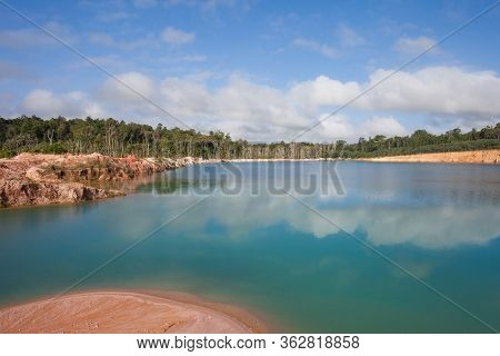 Turquoise Beautiful Lake Formed After Mining Bauxite In Subtropical Forests On A Clear Sunny Day. Na