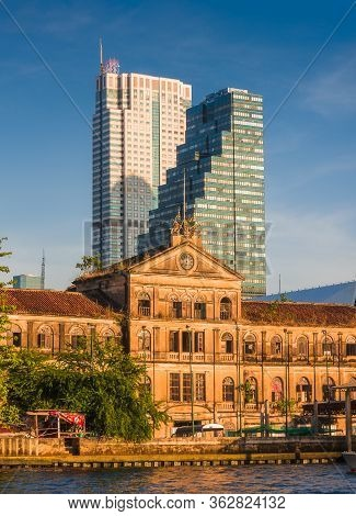 Beautiful Old Customs House And Skyscrapers In Golden Light In Bangkok, Thailand